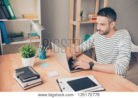 Smiling Smart Businessman In Glasses Working In Office With Laptop