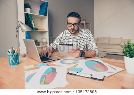 Smart Man In Glasses Holding Tablet And Working With Diagramas