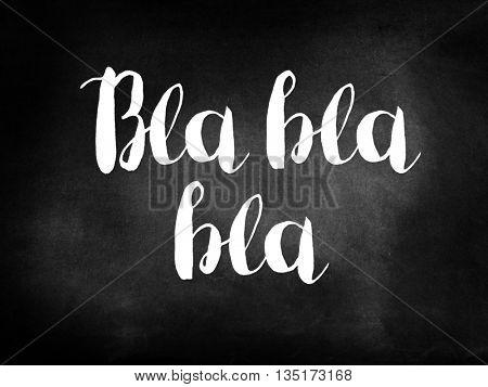 Bla bla bla written on a blackboard