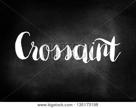 Crossaint written on a blackboard