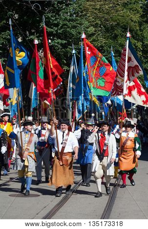ZURICH - AUGUST 1: Swiss National Day parade on August 1, 2009 in Zurich, Switzerland. Representative of professional guilds in a historical costumes.