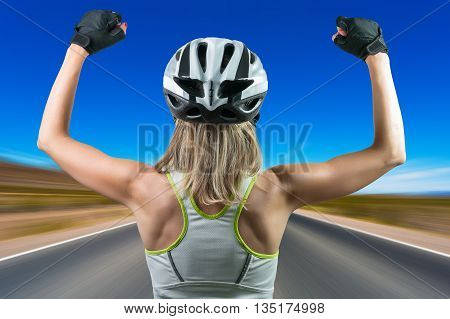 Excited cyclist enjoying the win. Concept Winning in sports.