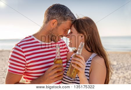 couple celebrating fiesta on the summer beach