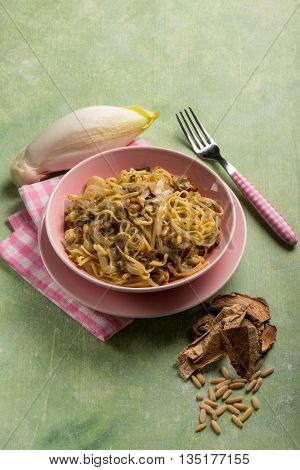 tagliolini with dried mushroom pinenuts and endive salad