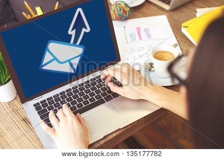 Sending message. Close up of smart woman using a laptop for communication
