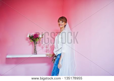 Smiled Young Girl Bride At Veil Background Pink Wall With Windowsill Flowers And Candlestick
