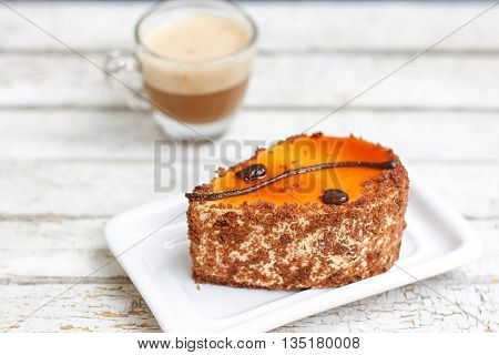 coffee cake and cup of coffee on old wooden table