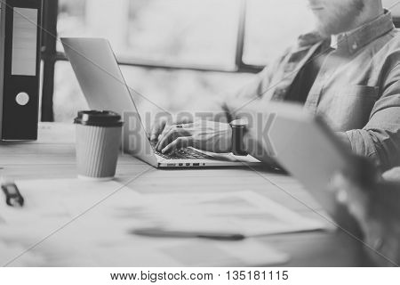 Photo Sales Manager Working Modern Office.Bearded Man Use Generic Design Laptop.Account Department Work New Startup Project.Researching Process at Wood Table.Horizontal.Blurred Background.Black White