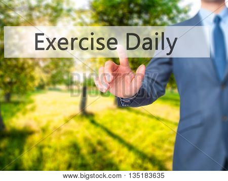 Exercise Daily - Businessman Hand Pressing Button On Touch Screen Interface.