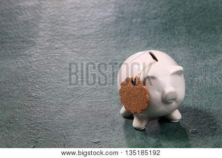piggy bank with tag on the blackboard