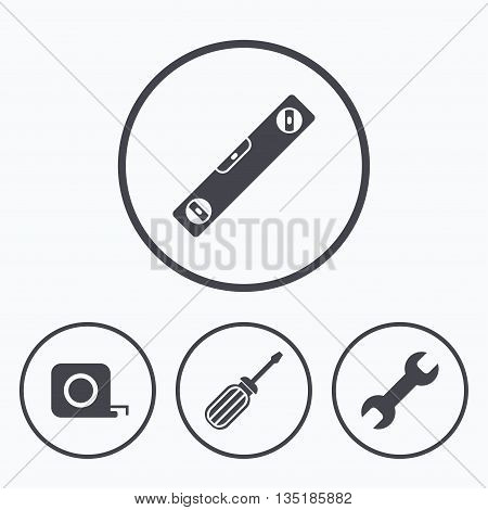 Screwdriver and wrench key tool icons. Bubble level and tape measure roulette sign symbols. Icons in circles.