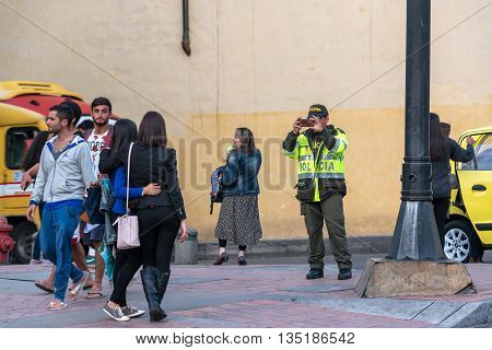Police Officer Taking Picture