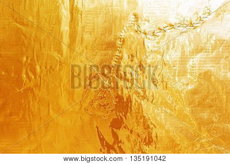 Shiny Yellow Leaf Gold Foil Texture For Background.