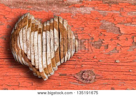 Sliced Bread Loaf Shaped As Heart Over Old Surface