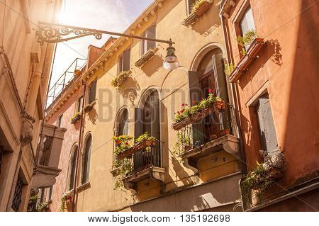 Beautiful old building balconies with colorful flowers