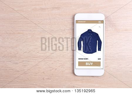 white color smartphone on a wooden background