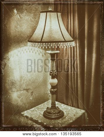 antique lamp displayed on end table near drapery