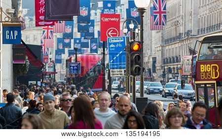 LONDON, UK - OCTOBER 4, 2015: Regent street with lots of walking people crossing the road. Shopping at west end