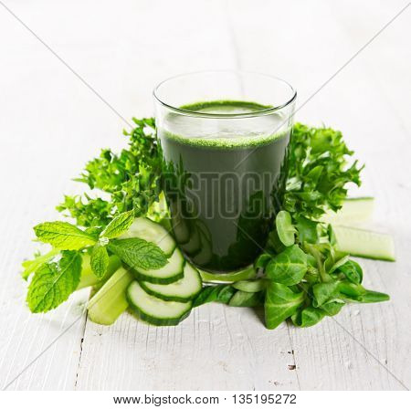 Healthy green vegetable smoothie, close-up.
