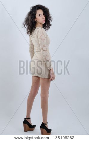.young Latin Exotic Girl Wearing A Beige Dress Looking At Camera