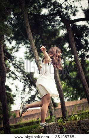 teen girl play in park summer day full body shot