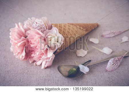 Pink Carnation Flowers In Ice Cream Waffle Cone,selective Focus