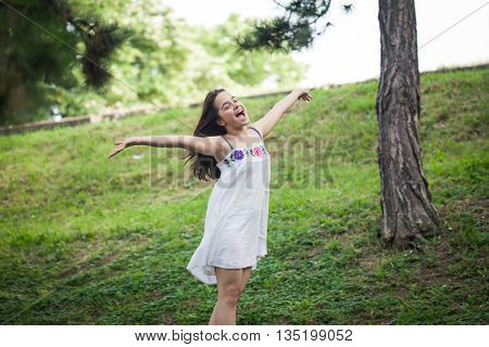 teen girl enjoy in summer day in park