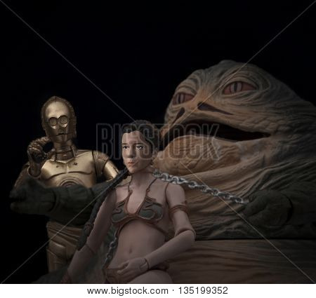 BLOOMFIELD NJ - JUNE 19 2016: Recreation of a scene from Star Wars Return of the Jedi where Jabba the Hutt holds Princess Leia as a slave at his palace on Tatooine - dramatic lighting