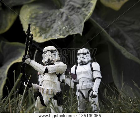 BLOOMFIELD NJ - JUNE 19 2016: Star Wars Stormtrooper action figures creating a fantasy scene in a rainy swamp