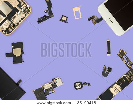 Flat lay (Top view) of smart phone components isolate on purple background with copy space