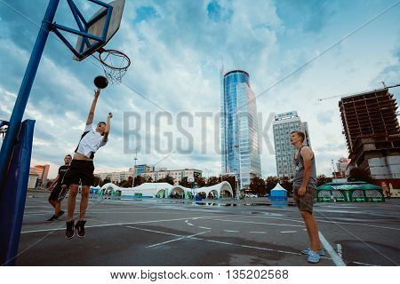 Minsk, Belarus - June 20, 2014: Young People Play Street Basketball In The Center Of Minsk In The Evening