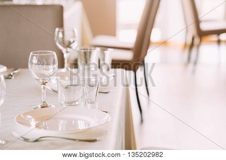 Cozy Interior Of Summer Cafe - Sheltered Tables With Tablecloths