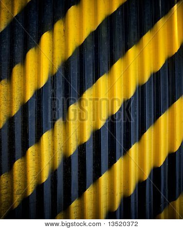 metal fence with warning stripe