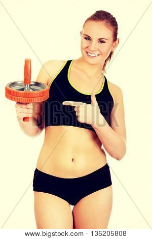 Young and sporty woman holding sport wheel