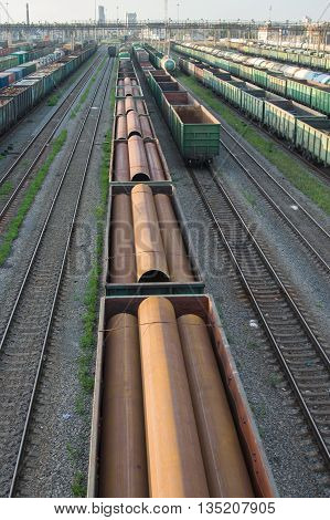 Trains With Industrial Goods Stand On The Rails