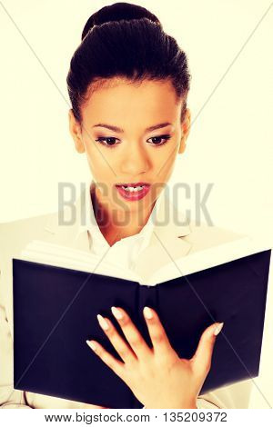Shocked businesswoman with a notebook.