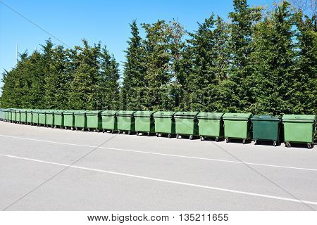 Long Row Of Garbage Cans In Park