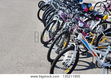 Walking bikes for rent on city street at sunny day