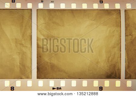 Film negative frames on brown paper