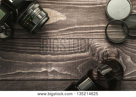 Photo Camera On Wooden Rustic Background
