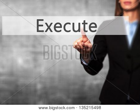 Execute - Businesswoman Hand Pressing Button On Touch Screen Interface.
