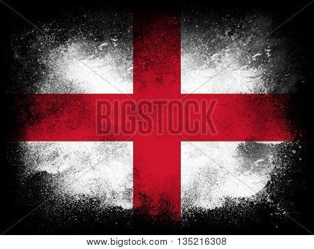 Powder paint exploding in colors of the Republic of England flag isolated on black background. Abstract particles explosion of colorful dust.