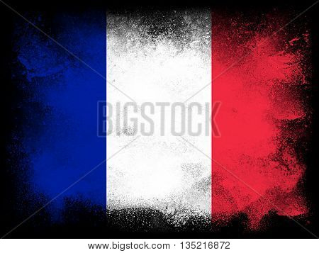 Powder paint exploding in colors of France flag isolated on black background. Abstract particles explosion of colorful dust.
