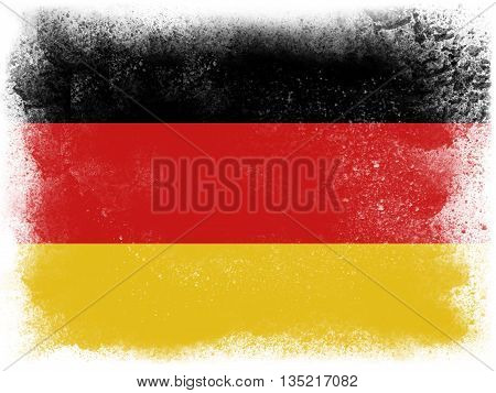 Powder paint exploding in colors of the Germany flag isolated on white background. Abstract particles explosion of colorful dust.