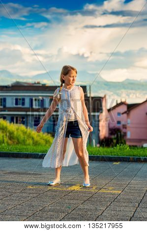Fashion portrait of a cute little girl of 8-9 years old