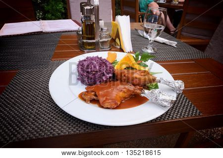 duck thigh on stewed red cabbage bed, Romania