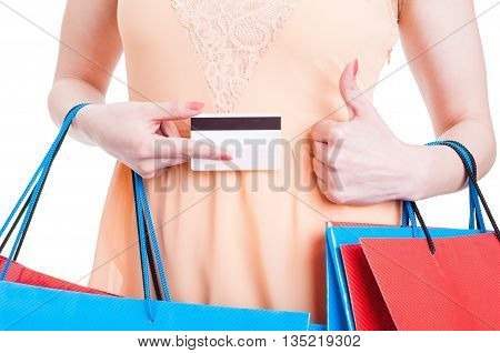 Close-up Of Lady Holding Credit Card And Thumb Up