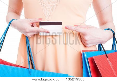 Close-up Of Woman Holding Credit Card And Pointing On It
