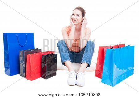 Lady Shopper Sitting Around Shopping Bags And Feeling Pensive