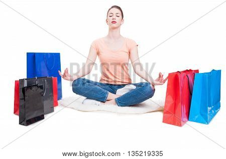 Lady Sitting With Shopping Bags Around And Smiling